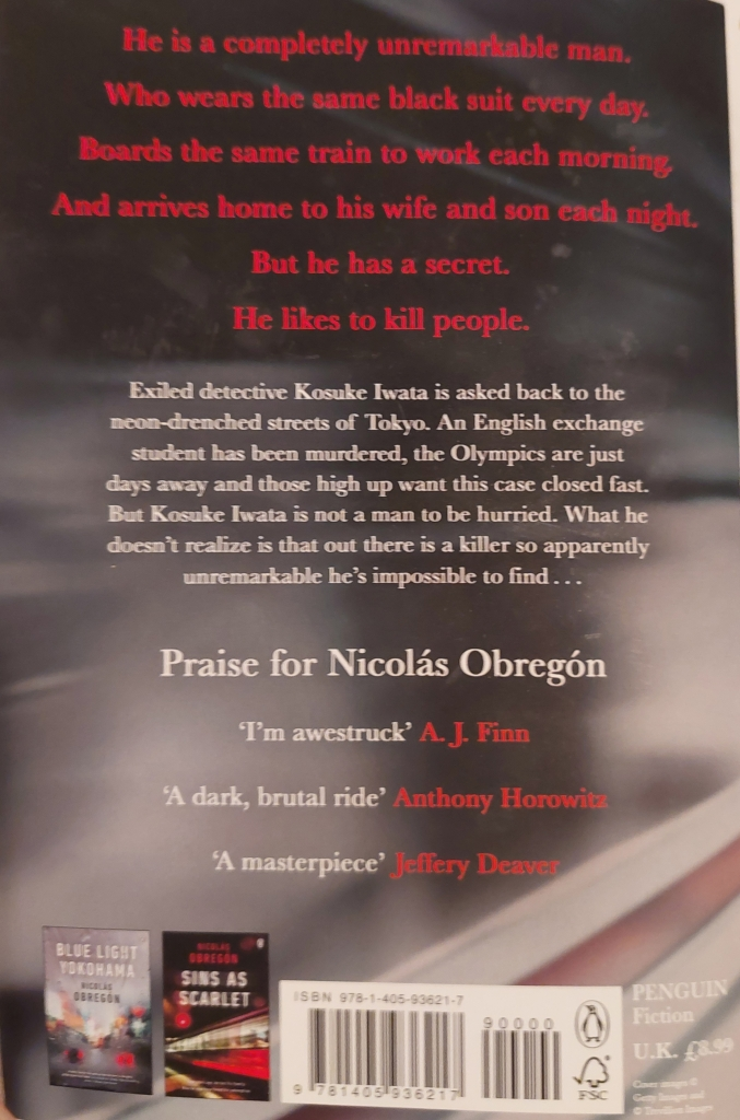 A photo of the back cover of 'Unknown Male' by Nicholas Obregon.  Features the text: He is a completely unremarkable man.  Who wears the same black suit every day.  Boards the same train to work each morning, and arrives home to his wife and son each night.  But he has a secret.  He likes to kill people.