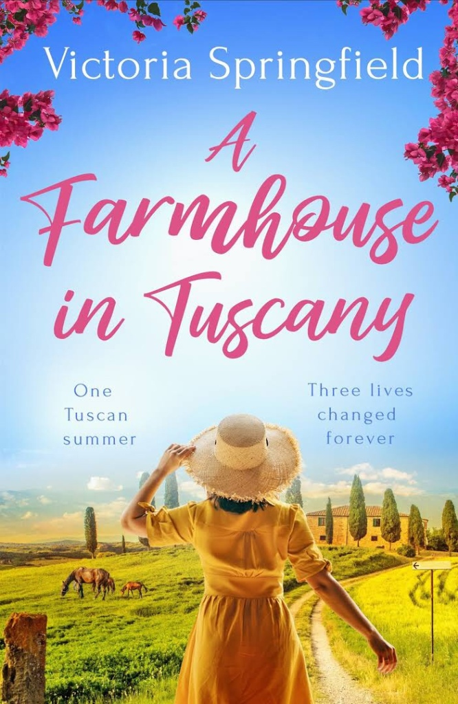 The picture is of the front cover of 'A Farmhouse in Tuscany' by Victoria Springfield.  It features a woman in a straw hat facing away from the reader.  She is overlooking a scene of the Tuscan countryside, which includes a horse.