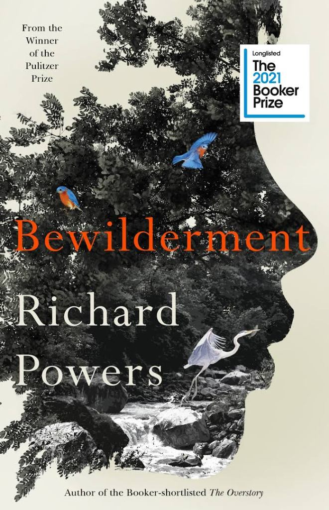 The picture shows the front cover of 'Bewilderment' by Richard Powers.  It features the sillohette of a boys face which is filled with a photo a stream with a heron.